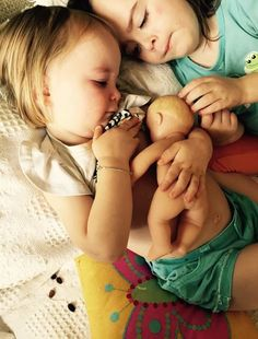 Children modeling breastfeeding in the sweetest way.