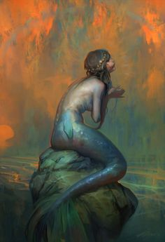 At the end of day when sunset has covered the sky with its multi colors, the mermaid sits and waits for the moon to take over the the night and scatter it's stars.  ©mdh