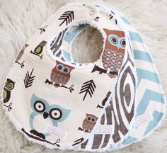 Such a cute owl bib set for all the little baby boys out there. This super trendy woodland bib set features an owl and arrow bib, a blue chevron bib and a wood grain print bib. This owl bib set would