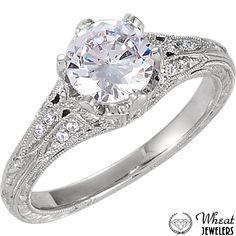 Antique Style 6 Prong Engagement Ring with Hand Engraving and Accent Diamonds available at Wheat Jewelers #engagementring