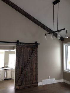 Z Barn door and matching beams handmade by GOATGEAR right here in the Okanagan. Interior Sliding Barn Doors, Barn Door Hardware, Beams, Track Lighting, Ceiling Lights, Curtains, Kit, Rustic Barn, House