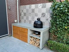 Finished my backyard playground. Made from concrete and oak. Very happy with the result! Outdoor Garden Bar, Outdoor Bbq Kitchen, Outdoor Barbeque, Outdoor Kitchen Design, Bbq Outdoor Area, Bbq Area Garden, Small Outdoor Kitchens, Built In Outdoor Grill, Built In Bbq