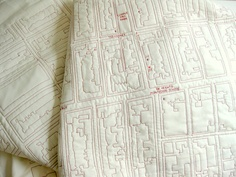 """Tactile Maps by Emily Fischer who researches digital information such as open source mapping to find a density of data that conforms to """"Amish rules of quilting"""". Each resultant quilt is a tactile map."""