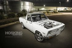 https://flic.kr/p/GKtVtd | Peter La Spada's Datsun 1200 Ute | Our photo shoot on Peter la Spada's immaculate restomod Datsun 1200 ute was featured in the last issue of Fast Fours magazine! It's a gorgeous little thing that boasts tons of neat detail with only minimal mods for some more 'go' and a touch more 'show'. BUY A PRINT: www.redbubble.com/people/hoskingind/works/15857943-peter-... www.hoskingindustries.com.au. www.facebook.com/HoskingIndustries