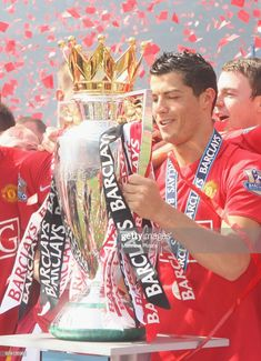 Cristiano Ronaldo of Manchester United celebrates with the Premier League trophy after the Barclays Premier League match between Manchester United and Arsenal at Old Trafford on May 16 in. Get premium, high resolution news photos at Getty Images Cristiano Ronaldo Manchester, Cristiano Ronaldo Portugal, Cristiano Ronaldo Junior, Cristino Ronaldo, Cristiano Ronaldo Wallpapers, Cristiano Ronaldo Juventus, Cristiano Ronaldo Cr7, Old Trafford, Cr7 Wallpapers