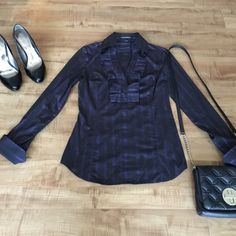 Express Collared V-neck Blouse Black Express top with purple striped.  Size xs. Long sleeves, pleated ruffle v-neck, side zip.  Used but in good condition small very hard to notice spot (see pic set 3) Express Tops Blouses