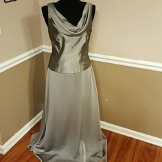 Beautiful Dress (2-piece) Color: Platinum; Satin top with drape front and flowy floor length skirt; worn once in a wedding; size runs slightly smaller; priced to sell together; will provide measurements if requested David's Bridal Skirts