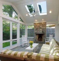 A #sunroom with a #fireplace.