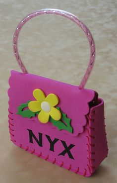 2012 Krewe of NYX Inaugural Year Signature Member Throw. Pink Poly/Foam Purse