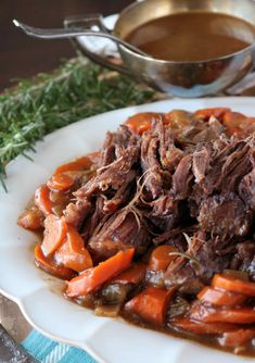 Make this easy comfort food dinner featuring perfect, fork-tender pot roast made in the oven! The recipe features beef chuck shoulder braised in beef broth and red wine, with carrots, onions and fresh herbs. Chuck Roast In Oven, Chuck Roast Recipe Oven, Oven Pot Roast, Chuck Roast Recipes, Beef Chuck Roast, Pot Roast Recipes, Cooking Recipes, Roast In The Oven, Dutch Oven Roast Beef