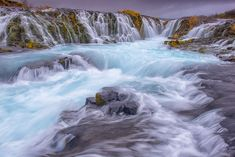 Bruarfoss Waterfall is located in Iceland. The blue color of the water comes from a saturation of glacial silt. Most of Iceland receives their power from geothermal water and water pressure from the rivers. Iceland is not an area to just randomly put your foot in the water as chances are that it is scalding hot. Eco friendly and climate conscience Iceland seems to be reversing climate change in their region.