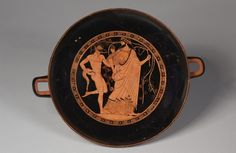 Drinking Cup (Kylix), c. 480 BC  attributed to Douris (Greek) Dionysis and satyr earthenware with slip decoration, Diameter - w:29.60 cm (w:11 5/8 inches)...