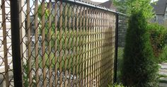 "Here is a simple way to add privacy (ok, a tiny bit) and some interest to a chain link fence.  Simply rip cedar slats 1"" X 1/4"" and 4-5 ft i..."