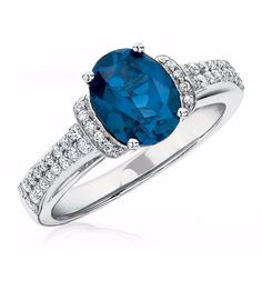 14K white gold ring with one 9x7 millimeter oval sapphire and 52 round single cut diamonds weighing approximately 1/3 ct. tw.