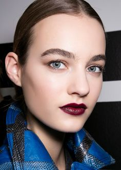 55 fall + winter makeup ideas to wear now | Jewel tone shadows, dark lips, rich hues—you'll love these cold-weather beauty looks! | Deep berry lipstick