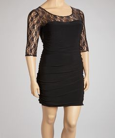 Sleek and sophisticated, this dress is designed to cater to curves. A layer of lace at the top adds feminine flair, while ruching at the sides slims the silhouette.  Size note: This item runs small. Ordering one size up is recommended.