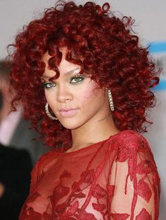 Rihanna's curly medium-red colored hair... I gotta admit I hated it when I 1st saw it in her video with Eminem, but I gotta say- she made me a convert, it just took a little time. <3 !!