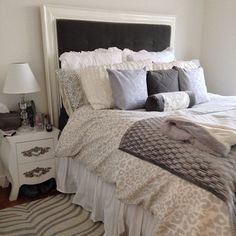 Our Snow Leopard Duvet Cover looks super cozy chic in this bedroom! // Love the gray tones that compliment with the dark gray headboard