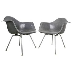 Designer: Charles Ray Eames. Manufacturer: Herman Miller. Period/Style: Mid-Century Modern. Country: United States. Date: 1960s.  30 in.Hx24 in.Wx24 in.D 76 cmHx61 cmWx61 cmD