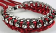 Carmine Chain Bracelet - A startling eye catcher made of Rhinestones dancing a gentle tango with a gracefully braided red cord. This elegant bracelet ensemble rests on a stainless steel chain and is held together by a stainless steel clasp with its signature 'Love Bibi' tag. Dazzle them all, by being the lady in red.