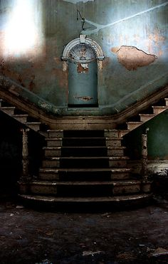 The grand entrance staircase of the now abandoned St Johns Mental Asylum in Bracebridge Heath, Lincoln, England. The hospital opened in 1852. It was built in Italian style by the architects Hamilton and Thomas Percy. It had 300 patients in the beginning but soon expanded to many more and the hospital was enlarged.    The hospital closed down in 1990.