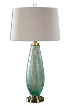 Presenting the Lenado Sea Green Glass table lamp created with a heavily frosted cut sea green glass lamp base accented with elegant antiqued brushed brass plated details. Coastal Lighting, Coastal Chandelier, Kitchen Chandelier, Coastal Entryway, Coastal Decor, Coastal Curtains, Coastal Bedding, Blue Bedding, Coastal Farmhouse