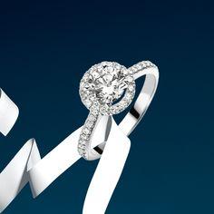 Celebrate life's mesmerizing journey with #Bucherer's unique Entourage #diamond #ring. #MomentsOfRomance #weddingseason #bridal #jewelry