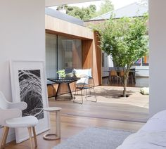 Courtyard House designed by Matt Gibson Architecture + Design and featuring a range of Tait projects is a renovation of an original workers cottage.