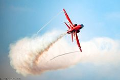 Stunning pictures captured the RAF's famous Red Arrows team in action above their Lincolnshire base RAF Scampton yesterday, pictured, as they took part in winter training ahead of their traditional summer displays