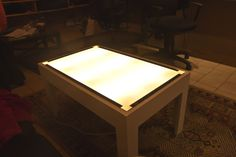A big backlit table with square and hex laminate put on top to make an instant scenery. Just add print out of scenery underneath to make a map.