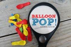 Pop balloon using magnifying glass.