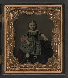 Unidentified girl in dress holding American flag and ball  Repository: Library of Congress Prints and Photographs Division Washington, D.C.