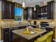 Transitional Kitchen with Raised panel, Pendant Light, Breakfast bar, Simple granite counters, Kitchen island, L-shaped