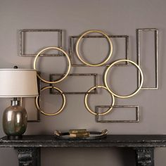 ELIAS METAL WALL DECOR A fun combination of iron circles and rectangles finished in rich, brushed bronze and gold leaf. A striking design to complete any setting. May be hung horizontal or vertical. Gold Metal Wall Art, Metal Wall Panel, Metal Wall Decor, Diy Wall Art, Diy Wall Decor, Metal Walls, Home Decor, Wall Décor, Modern Metal Wall Art