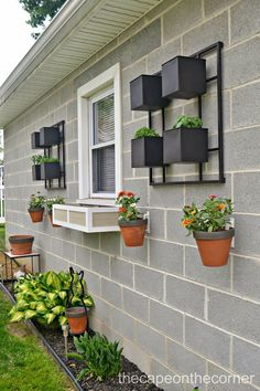 Design a concrete wall with hanging flower pots using hangapot hangers. Design a concrete wall with Outdoor Planters, Outdoor Walls, Outdoor Living, Outdoor Decor, Living Wall Planter, Wall Planters, Patio Wall, Planter Boxes, Garden Planters