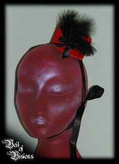 A sweet little pillbox hat with feather, ribbons and satin rose decoration. £17    Ties under the chin with lovely satin ribbons.