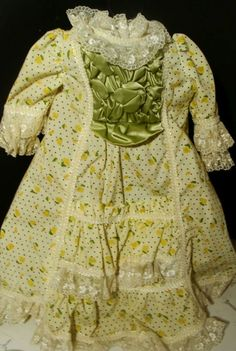 """___18"""" Doll Clothing Victorian OOAK Vintage Dress Ruffle Gown Craft Lacy Bisque Head ___ Hi there...... original 18"""" long... hand sewn crafted stunning Victorian doll style dress.  This comes from a bisque head antique doll in disrepair.  White with the green print fabric and the green satin front ruffle.  18"""" long and 7"""" wide under the arms.  3 snap in the back.  Please note...there is about 1/2"""" seam separation on the back."""