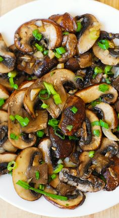 Mushrooms sauteed with garlic in olive oil and topped with green onions (or chives):  juicy and delicious meal, with a meaty flavor and texture!  Great vegetarian dish or side dish for grilled steak. #vegetables #healthy #gf #gluten_free #paleo #diet