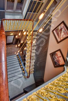 The Old Blind School, Liverpool, staircase, patterned tiles, yellow bannister, bulb pendant