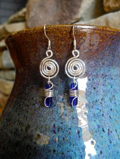 Silver spirals w/ wire wrapped blue bead. $12.00, via Etsy.