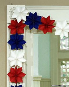 Fashioned from red, white, and blue paper stars, this festive garland adds a patriotic touch to a doorway or mantel.