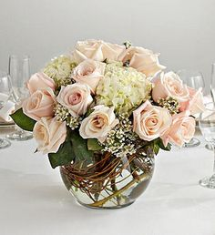 Love the shape of the glass vase and the curly willow. This could be done in any color scheme.