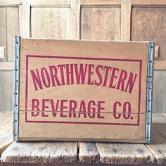 VINTAGE WOOD CRATE, NORTHWESTERN BEVERAGE CO CRATE, CHICAGO, ILLINOIS WOOD SODA CRATE, VINYL RECORD STORAGE  Fabulous 1970s Northwestern Beverage Co. wood shipping crate. Sturdy, thick wood walls. Useful and displays great. Bold red script on all four sides. Excellent condition overall. Normal wear from use, scuffs, scratches. Clean and ready to be repurposed. Lengthwise, fits vinyl nicely.  Check out our other crates and decorative storage here…