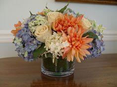 Winter Silk Flower Arrangements | beautiful arrangement of peach, cream and blue flowers in a glass ...