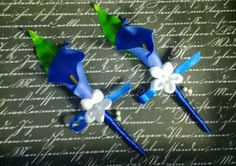 This listing is for 2 Beautiful Matching Real Touch Royal Blue Calla Lily Boutonnieres, with a white stephanotis accent flower with pearl pin in the center, leaf, wrapped in Royal Blue Satin ribbon. P
