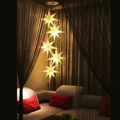 I would love to hang lanterns like this in a living room or stairway.