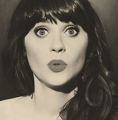 Zooey <3 she is so quirky and cute!  I adore her singing style/voice as well!