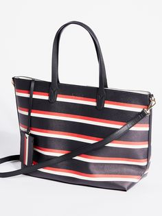 Lola Stripe Tote | Perfect sized carry-everything vegan leather tote featuring a striped design.    * Large and removable zipper pouch   * Attached ID tag   * Removable and adjustable long strap   * Magnetic snap closure
