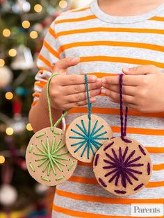 "Let your child practice his fine motor skills with this simple design. Cut circles from cardboard and punch a pattern with a thick nail; your kid can ""sew"" the design with a plastic embroidery needle and yarn."