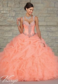 89023 Quinceanera Gowns Ruffled Organza Skirt with Embroidered and Beaded Bodice.